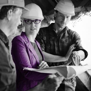 Image of a female architect with construction workers